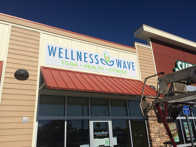 The Wellness Wave Yoga wall sign - 4' x 14' full color.