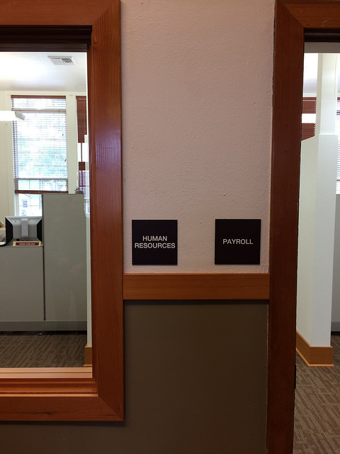 Interior door panel signs mark each room for easier navigation around the building.