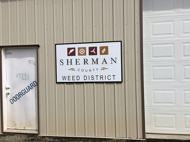 The main sign for the Sherman County Weed District building.